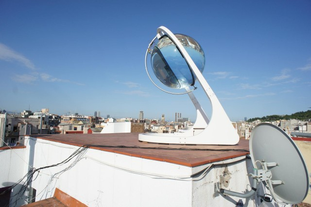 Figure 1: Enormous Ball Lens Used for Concentrating Sunlight Onto a Solar Panel.