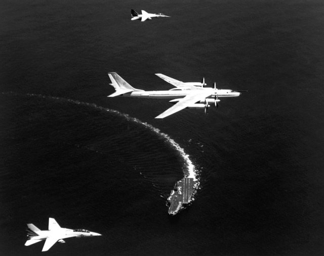Figure 2: Fighters Flying Top Cover Over the Aircraft Carrier Kitty Hawk.